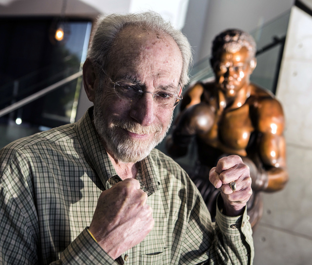 Marc Ratner, vice president of regulatory affairs with the Ultimate Fighting Championship and former executive director of the Nevada State Athletic Commission, poises in front of a statue of boxe ...