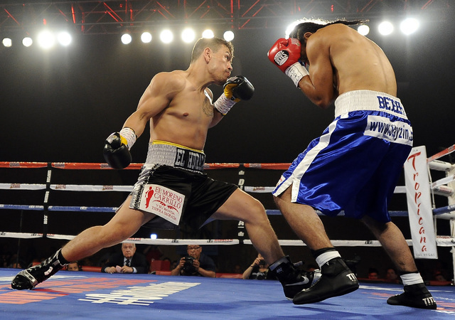 Las Vegas boxer Jesus Gutierrez, left, fights Pablo Becerra in the first round of their lightweight bout at the Tropicana Hotel Pavilion in Las Vegas Saturday, May 31, 2014. (Josh Holmberg/Las Veg ...
