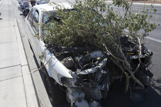 Branches are seen in the engine of a vehicle that crashed near the intersection of West Sahara Avenue and South Decatur Boulevard in Las Vegas on Saturday, June 25, 2016. Richard Brian/Las Vegas R ...