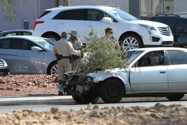 Metro officers are shown at the scene of a car crash near the intersection of West Sahara Avenue and South Decatur Boulevard in Las Vegas on Saturday, June 25, 2016. Richard Brian/Las Vegas Review ...
