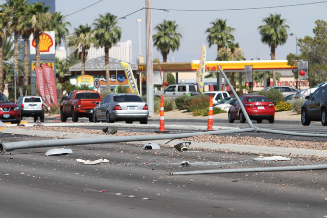 Light poles are seen knocked over at the scene of a crash near the intersection of West Sahara Avenue and South Decatur Boulevard in Las Vegas on Saturday, June 25, 2016. Richard Brian/Las Vegas R ...