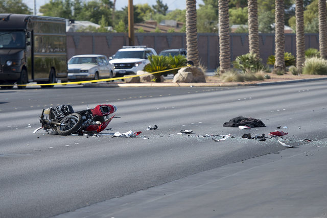 A motorcycle lays in the road after a crash that involved it and a four-door vehicle at the intersection of Washington Avenue and Martin Luther King Boulevard in Las Vegas on Wednesday, June 22, 2 ...