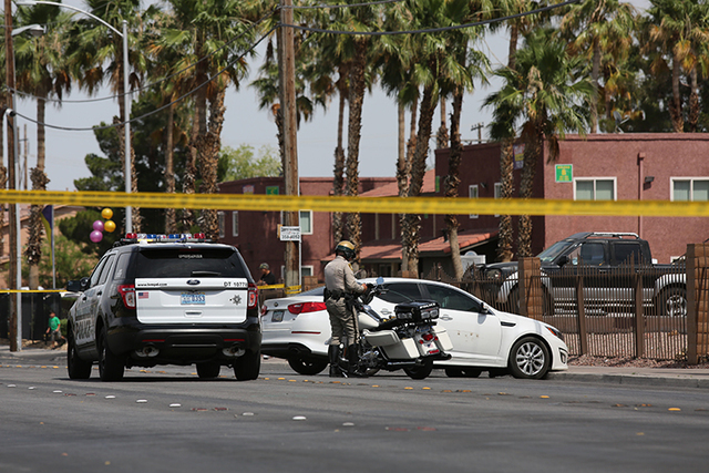 Police tape surrounds a white Kia involved in an accident near 28th street and Cedar avenue on Friday, June 10, 2016. Police are working to apprehend shooting suspects near the downtown area. (Bre ...