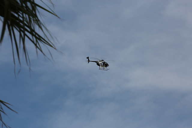 A police helicopter flies over Bonanza Road as it searches for a suspect on Friday, June 10, 2016. Police are working to apprehend shooting suspects near the downtown area.  (Brett Le Blanc/Las Ve ...