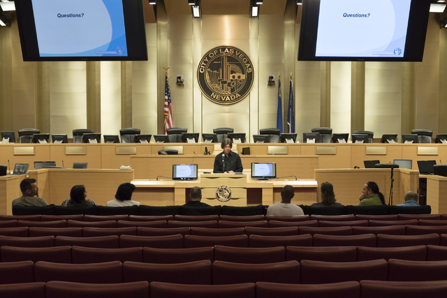 Brad Jerbic, Las Vegas city attorney, speak with buskers about new rules for the downtown performers during a meeting at Las Vegas City Hall Council Chambers Thursday, March 10, 2016. Jason Ogulni ...