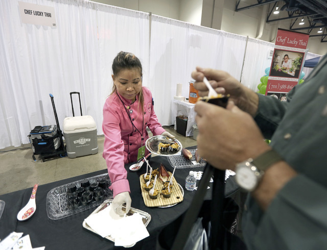Chef Lucky Thai serves Thai food during the Business Expo sponsored by Las Vegas Metro Chamber at Cashman Field on Wednesday, June 15, 2016.  Jeff Scheid/Las Vegas Review-Journal Follow @jlscheid