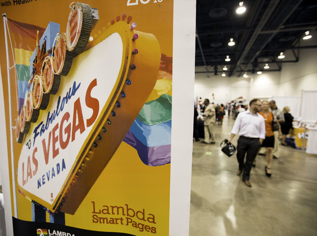 People walk near the Lambda Smart Pages booth during the Business Expo sponsored by Las Vegas Metro Chamber at Cashman Field on Wednesday, June 15, 2016.  Jeff Scheid/Las Vegas Review-Journal Foll ...