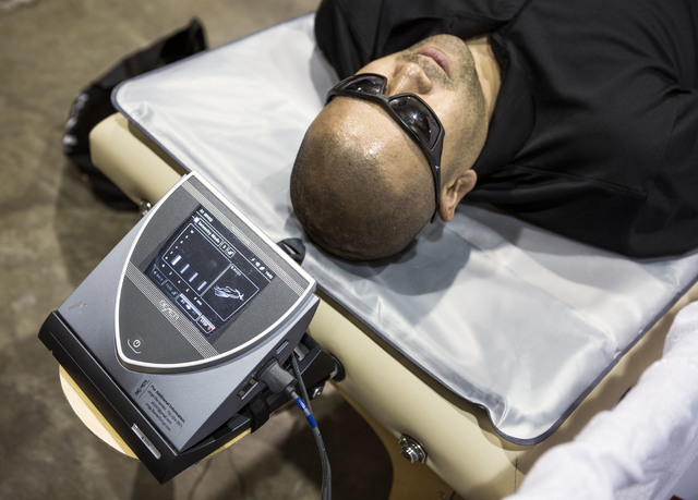 Alfred (declined to give last name) lays on a Bremer Group wellness device during the Business Expo sponsored by Las Vegas Metro Chamber at Cashman Field on Wednesday, June 15, 2016.  Jeff Scheid/ ...