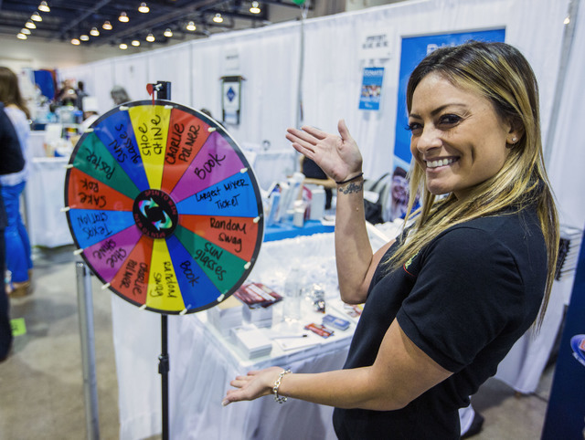 Kristen Alesna stands in front of a wheel of fortune at the Largest Mixer during the Business Expo sponsored by Las Vegas Metro Chamber at Cashman Field on Wednesday, June 15, 2016.  Jeff Scheid/L ...