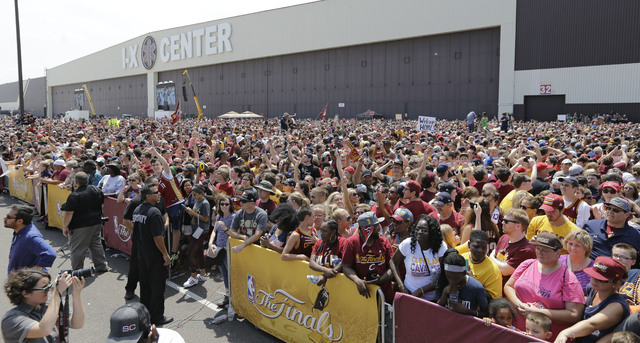 A large crowd of Cleveland Cavaliers fans wait for the arrival of the team in Cleveland, Monday, June 20, 2016. Lebron James came home with the trophy he promised, and the championship Cleveland h ...