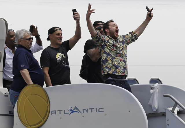 Cleveland Cavaliers' Matthew Dellavedova, from Australia, yells to fans after arriving in Cleveland, Monday, June 20, 2016. The Cavaliers defeated Golden State in Game 7 of the NBA Finals on Sunda ...