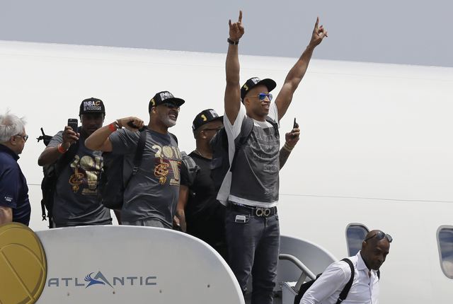 Cleveland Cavaliers' Richard Jefferson raises his arms in celebration after arriving in Cleveland, Monday, June 20, 2016. The Cavaliers defeated Golden State in Game 7 of the NBA Finals on Sunday  ...