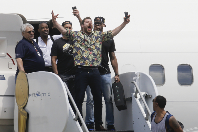 NBA champion Cleveland Cavaliers' Matthew Dellavedova, center, celebrates with teammates as they arrive at the airport Monday, June 20, 2016, in Cleveland. (John Minchillo/AP)