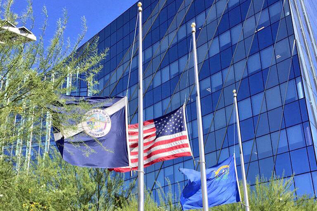 Flags at Las Vegas City Hall fly at half staff to honor the victims of the Orlando nightclub shooting. (Courtesy City of Las Vegas-Twitter)