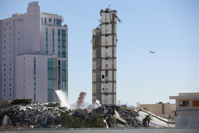 What remains of The Clarion hotel-casino is seen after a demolition crew worked to bring down part of the structure after an early-morning implosion failed to fully bring down the building at 305  ...