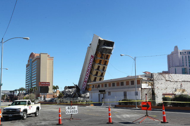Most of remaining portion of The Clarion hotel-casino is brought down by a demolition crew after an early-morning implosion failed to fully bring down the building at 305 Convention Center Drive i ...