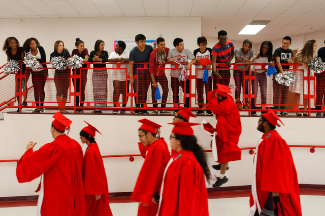 Valley High School seniors are cheered on by students as they participate in the first Grad Walk. (James Tensuan/Las Vegas Review Journal)