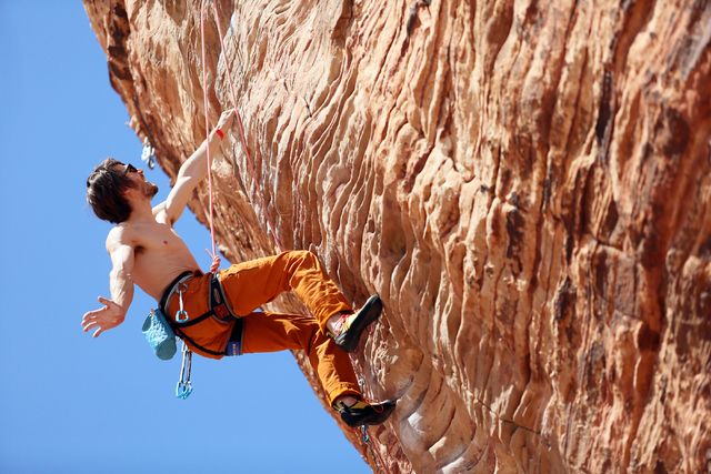 "Professional rock climber Ethan Pringle, of San Francisco, lead climbs along the ""New Wave Hookers"" route at Calico Basin in Red Rock Canyon National Conservation Area Sunday, March 29, 2015, near ..."