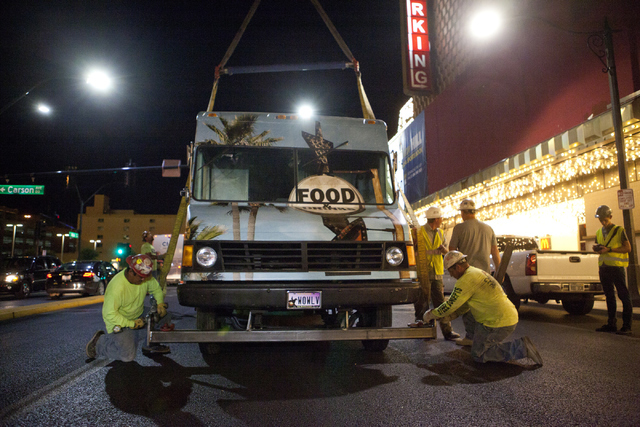 Workers prepare to hoist a Palm Springs-themed food truck to the rooftop of The Plaza on Thursday, June 9, 2016 in downtown Las Vegas. (Loren Townsley/Las Vegas Review-Journal Follow @lorentownsley)