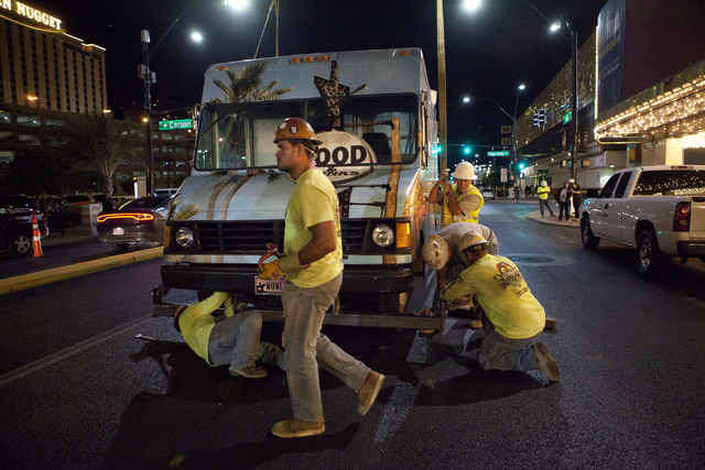 Workers prepare to hoist a Palm Springs-themed food truck to the rooftop of The Plaza on Thursday, June 9, 2016 in downtown Las Vegas. Loren Townsley/Las Vegas Review-Journal Follow @lorentownsley