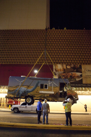 A crane hoists a Palm Springs-themed food truck to the rooftop of The Plaza on Thursday, June 9, 2016 in downtown Las Vegas. (Loren Townsley/Las Vegas Review-Journal Follow @lorentownsley)