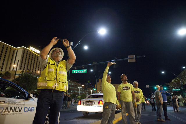 Workers photograph a crane hoisting the Palm Springs-themed food truck to the rooftop of The Plaza on Thursday, June 9, 2016 in downtown Las Vegas. (Loren Townsley/Las Vegas Review-Journal Follow  ...