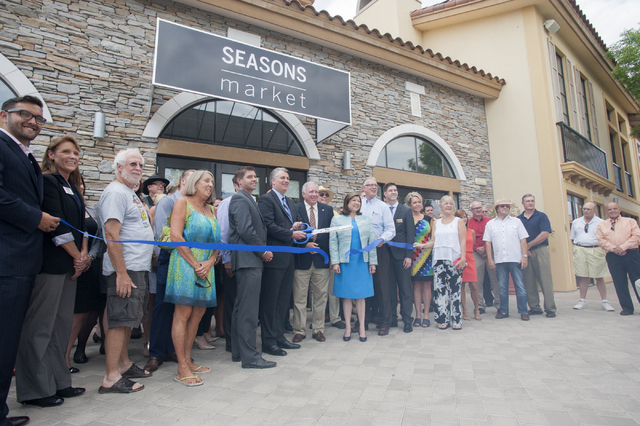 Patrick Parker, president of Raintree Investment Corp., center, cuts the ribbon at the new Seasons Market on Tuesday June 21, 2016, in MonteLago Village at Lake Las Vegas in Henderson. Steve Andra ...