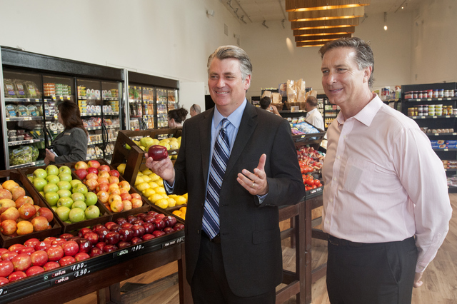 Patrick Parker, Raintree Investment Corp. president, left, and Doug McPhail, Seasons Market general manager mingle on opening day for the market on Tuesday, June 21, 2016, in MonteLago Village at  ...