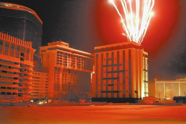 Fireworks blast from the top of the Monaco Tower at the shuttered Riviera shortly before being imploded on Tuesday, June 14, 2016.  Jeff Scheid/Las Vegas Review-Journal Follow @jlscheid