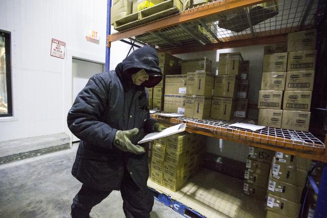 Antal Patt looks at his daily orders inside the freezer at the Anderson Dairy headquarters on Tuesday, June 28, 2016, in Las Vegas. (Erik Verduzco/Las Vegas Review-Journal) Follow @Erik_Verduzco