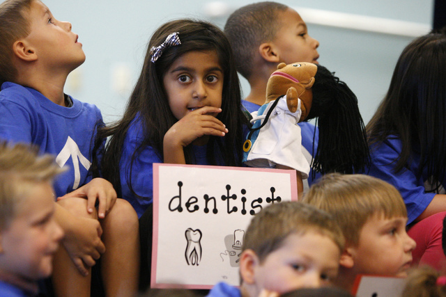 Kindergartner Sarina Khurana, center, 5, participates during an event to announce the second year of the Nevada College Kick Start Program at Bonner Elementary School in Las Vegas, Tuesday, Sept.  ...