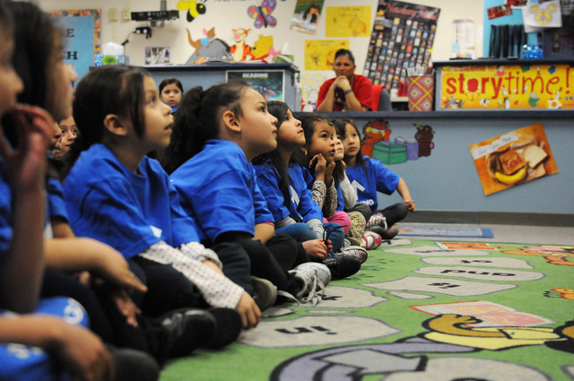 Kindergarten students at Bracken Elementary School in Las Vegas sit at their school's library during a media conference to discuss the launch of the Nevada College Kick Start Program Thursday, Feb ...