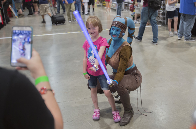 Isabella Costa, 5, poses for a photo with Mary Nocie during the Amazing Las Vegas Comic Con at the Las Vegas Convention Center on Saturday, June 18, 2016. (Richard Brian/Las Vegas Review-Journal)