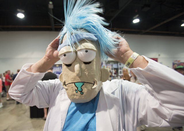 A fan in a costume adjust his wig during the Amazing Las Vegas Comic Con at the Las Vegas Convention Center on Saturday, June 18, 2016. (Richard Brian/Las Vegas Review-Journal)