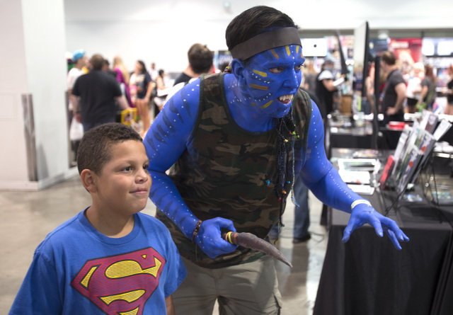 Seth Robertson, 9, left, poses for a photo with Matt Hillier during the Amazing Las Vegas Comic Con at the Las Vegas Convention Center on Saturday, June 18, 2016. (Richard Brian/Las Vegas Review-J ...