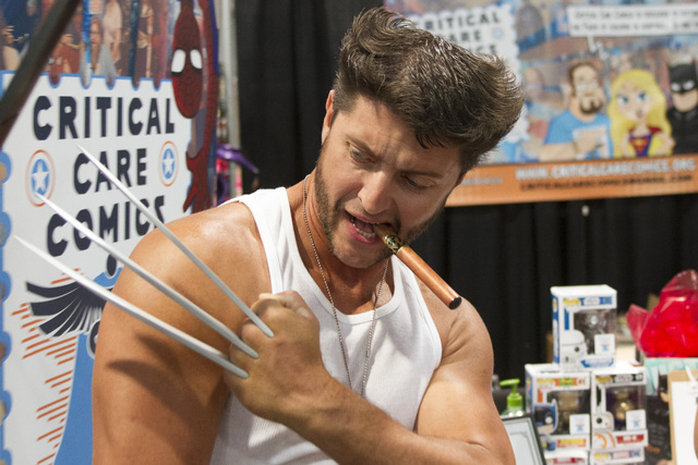 An enthusiast dressed as Wolverine shows off his costume props during the Amazing Las Vegas Comic Con at the Las Vegas Convention Center on Saturday, June 18, 2016. (Richard Brian/Las Vegas Review ...