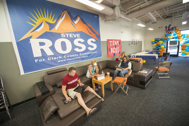 Campaign workers from the Steve Ross for Clark County Commissioner District B campaign make phone calls and analyze results on Tuesday, June 14, 2016 at his campaign headquarters in Las Vegas. (Ja ...