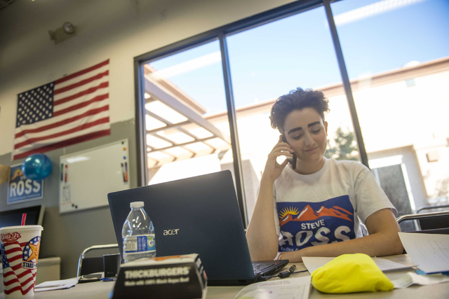 Lily Jackson, a volunteer and junior at Shadow Ridge High School, makes phone calls during the Steve Ross for Clark County Commissioner District B campaign on Tuesday, June 14, 2016 at his campaig ...