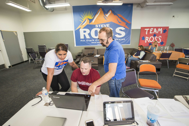 From left Cinthia Zermen, deputy campaign manager, Chris Lee, campaing manager, and Sean Bertram, campaign consultant, look over results during the Steve Ross for Clark County Commissioner Distric ...