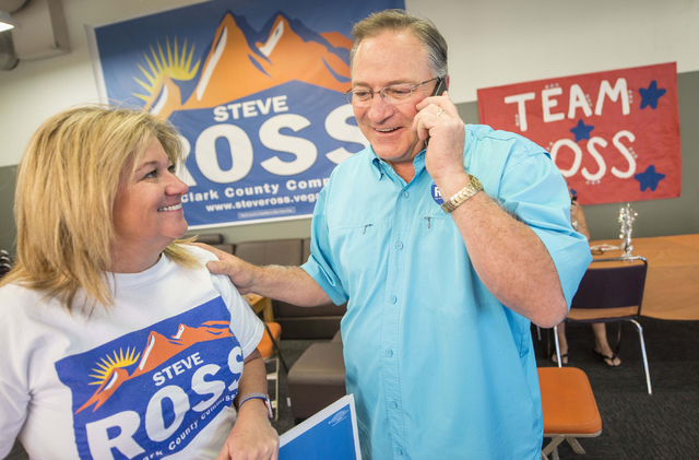Kelli Ross and her husband Steve make phone calls during the Steve Ross for Clark County Commissioner District B campaign on Tuesday, June 14, 2016 at his campaign headquarters in Las Vegas. (Jaco ...