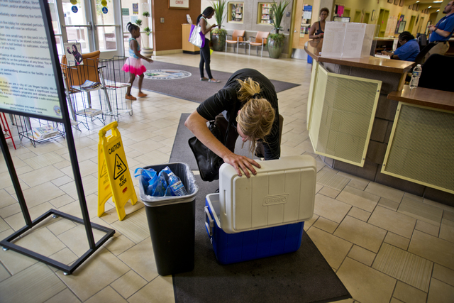 William Hackett takes water from a cooler at a cooling station located inside the Stupak Community Center in Las Vegas on Tuesday, June 21, 2016. Stations are situated across the Las Vegas Valley  ...