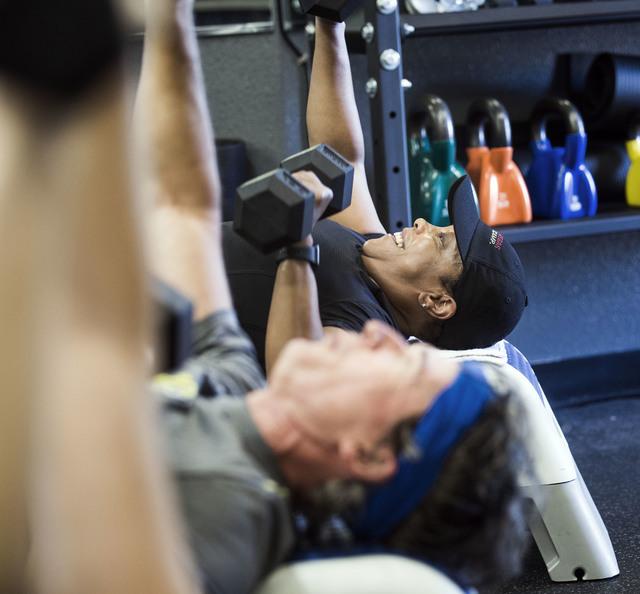 Katrina Harris lifts dumbbells during a Power Hour 360 class at Darling Tennis Center, 7901 W. Washington Ave. on Monday, June 13, 2016. Jeff Scheid/Las Vegas Review-Journal Follow @jlscheid
