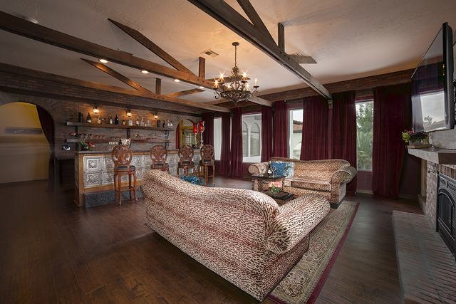 The master suite has a large sitting area. (COURTESY)