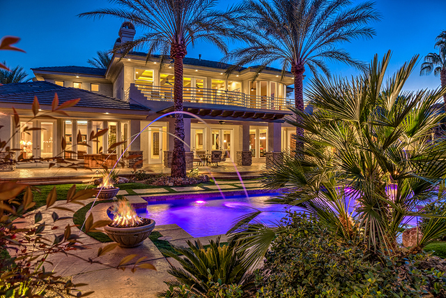 The $1.5 million Grand Legacy home features five fire pits in the resort-style backyard. (COURTESY OF LUXURY ESTATES INTERNATIONAL)