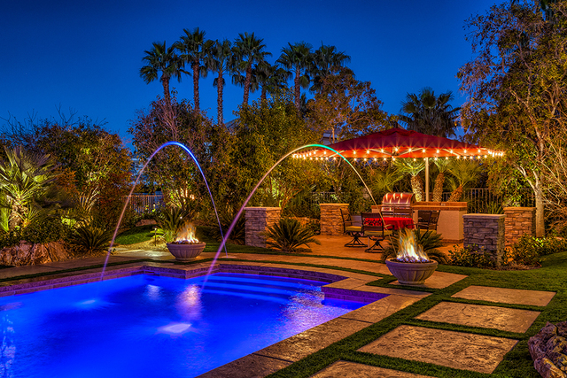 The backyard has an outdoor kitchen, fire features, pool and spa. (COURTESY OF LUXURY ESTATES INTERNATIONAL)