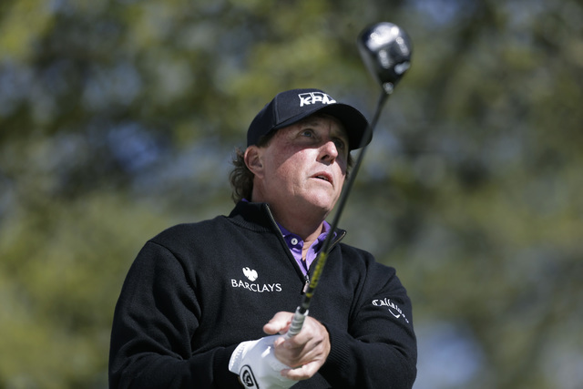 Phil Mickelson watches hit tee shot on the first hole during round-robin play against Daniel Berger at the Dell Match Play Championship golf tournament at Austin County Club, Thursday, March 24, 2 ...