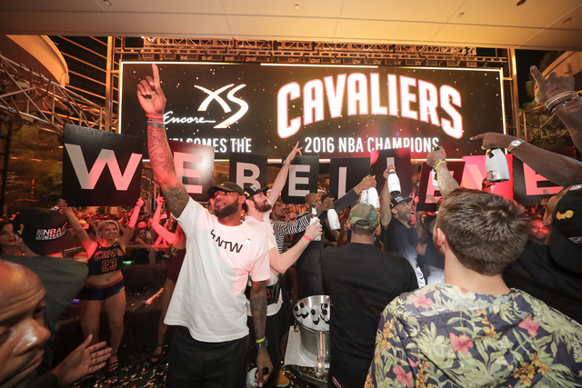 LeBron James, left, parties with teammates at XS nightclub at the Wynn after the Cleveland Cavaliers defeated the Golden State Warriors in Game 7 of the NBA championships Sunday. (Courtesy Tony Tr ...