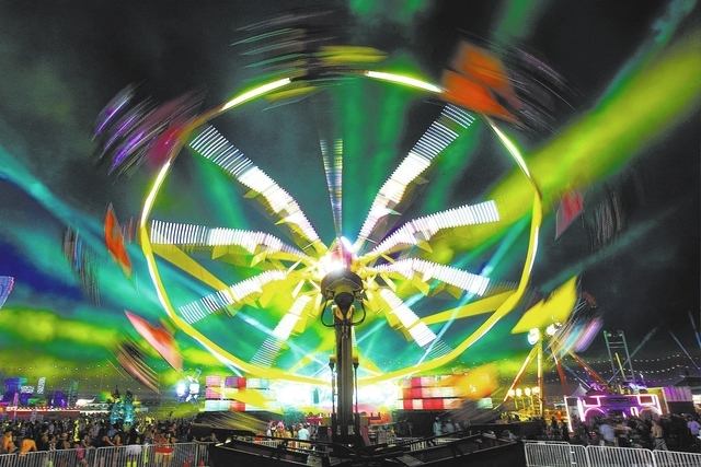 Lasers light up the sky as an amusement ride spins during the first night of the Electric Daisy Carnival Saturday, June 20, 2015 at the Las Vegas Motor Speedway.  (Sam Morris/Las Vegas Review-Jour ...