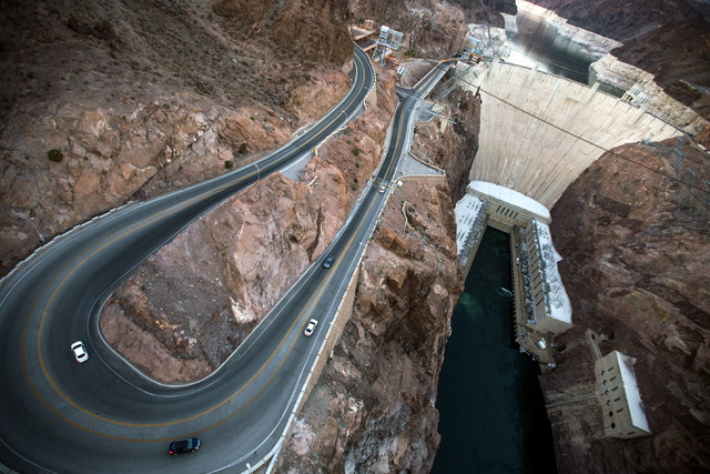 Light traffic is seen on the access road to Hoover Dam in this June 5 photo taken from the dam bypass bridge. Paid visitation has been declining at the iconic structure, though it still draws hund ...