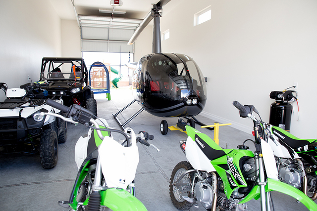 Member and Spring Mountain Estates resident Jeffrey Cheng has four garages. One houses his Robinson R-44 helicopter, bikes and all-terrain vehicles. (Tonya Harvey/Real Estate Millions)